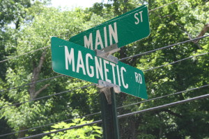 Street sign at the real corner of Magnetic and Main here in Eureka Springs. Can you see the spider web? Ooo. Nice effect.