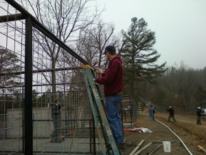 My husband, spraying the welding marks on the new enclosures on Rescue Ridge in last winter.