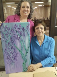 Artist Sue McCaniel with my new painting.