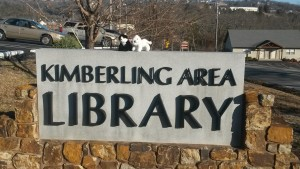 Kimba and Hiro's travel reps pose with the library sign. They were happy to get out and about after a few months off.